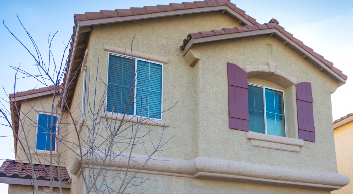 Can stucco be covered with siding